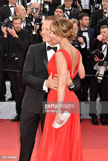 Rocco Siffredi and his wife Rozsa Tassi attend the'Money Monster' premiere during the 69th annual Cannes Film Festival at the Palais des Festivals on...