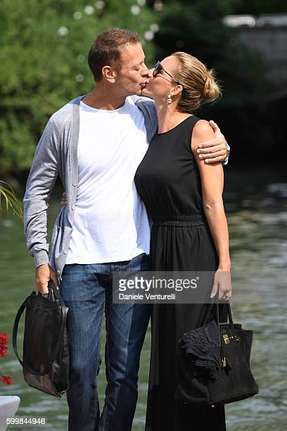 Rocco Siffredi kisses Rosa Caracciolo during the 73rd Venice Film Festival on September 7, 2016 in Venice, Italy.