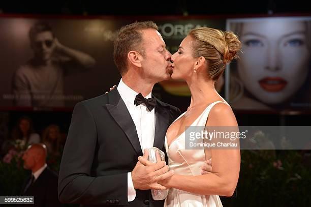 Rocco Siffredi kisses Rosa Caracciolo on the premiere of 'Rocco' during the 73rd Venice Film Festival at Sala Perla on September 5 2016 in Venice...