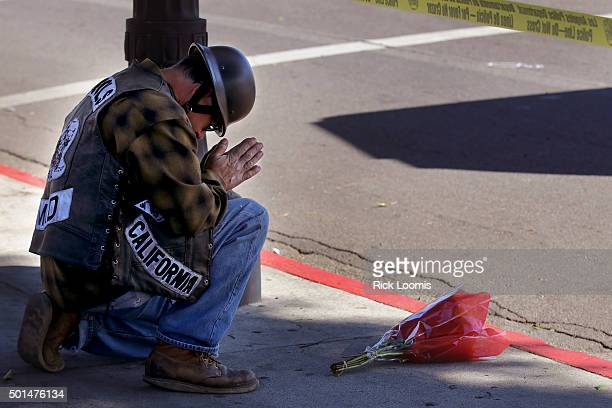 Rocco who preferred to not give his last name prays at the scene of a fatal accident after laying flowers at the scene I was drawn over here said...