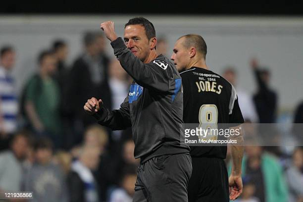 Rochdale manager Steve Eyre and goalscorer Gary Jones celebrate victory after the Carling Cup second round match between Queens Park Rangers and...