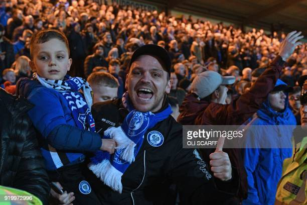 Rochdale supporters celebrate their late equalizer during the English FA Cup fifth round football match between Rochdale and Tottenham Hotspur at the...