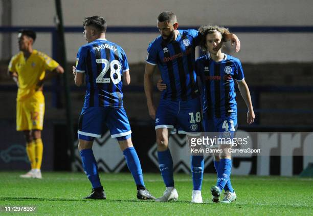 Rochdale's Aaron Wilbraham celebrates scoring his side's first goal with teammates Aaron Morley and Luke Matheson during the EFL Leasingcom Trophy...