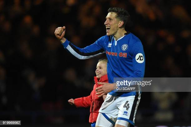 Rochdale's English defender Jimmy McNulty celebrates on the pitch after the English FA Cup fifth round football match between Rochdale and Tottenham...