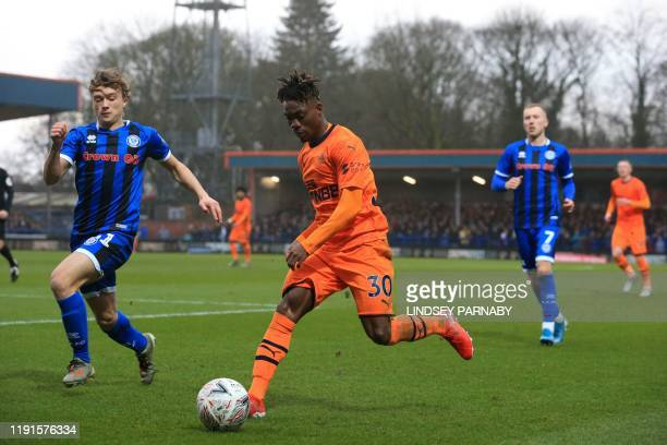 Rochdale's English defender Luke Matheson vies with Newcastle United's Ghanaian midfielder Christian Atsu during the English FA Cup third round...