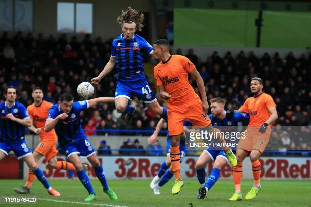 Rochdale's English defender Luke Matheson vies with Newcastle United's English midfielder Isaac Hayden during the English FA Cup third round football...