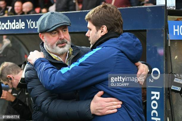 Rochdale's English manager Keith Hill greets Tottenham Hotspur's Argentinian head coach Mauricio Pochettino ahead of the English FA Cup fifth round...
