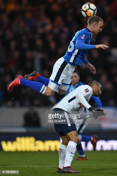 Rochdale's English midfielder Matt Done climbs above Tottenham Hotspur's Brazilian midfielder Lucas Moura during the English FA Cup fifth round...