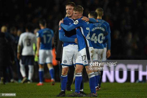 Rochdale's English midfielder Oliver Rathbone and Rochdale's English midfielder Andy Cannon celebrate on the pitch after the English FA Cup fifth...