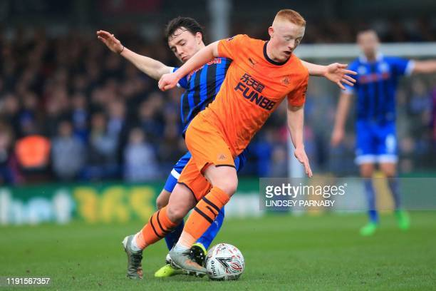Rochdale's English midfielder Oliver Rathbone vies with Newcastle United's English midfielder Matthew Longstaff during the English FA Cup third round...