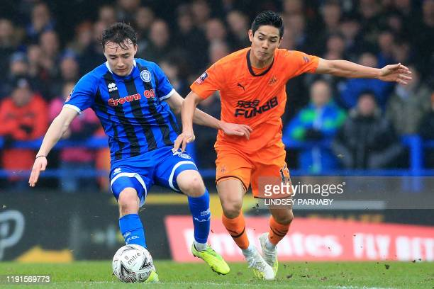 Rochdale's English midfielder Oliver Rathbone vies with Newcastle United's Japanese striker Yoshinori Muto during the English FA Cup third round...