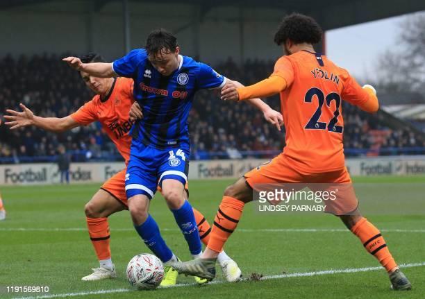 Rochdale's English midfielder Oliver Rathbone vies with Newcastle United's Japanese striker Yoshinori Muto and Newcastle United's US defender DeAndre...