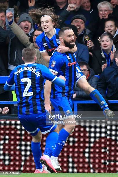 Rochdale's English striker Aaron Wilbraham celebrates with teammatesa after scoring his team's first goal during the English FA Cup third round...