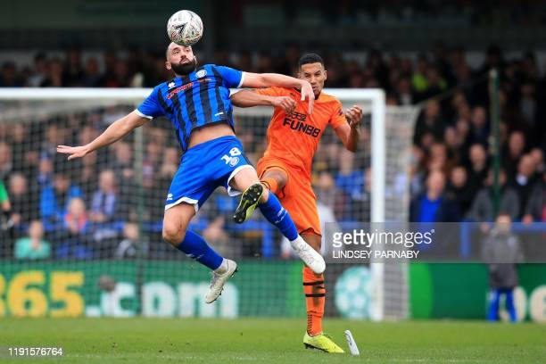 Rochdale's English striker Aaron Wilbraham vies with Newcastle United's English midfielder Isaac Hayden during the English FA Cup third round...