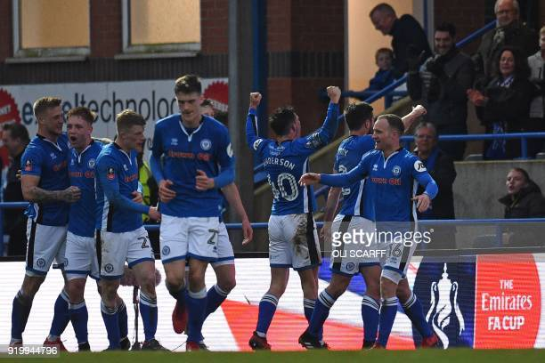 Rochdale's English striker Ian Henderson celebrates with teammates after scoring the opening goal of the English FA Cup fifth round football match...