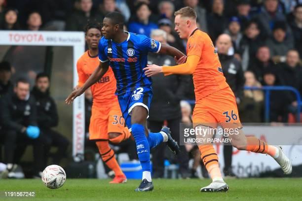 Rochdale's English striker Kwadwo Baah vies with Newcastle United's English midfielder Sean Longstaff during the English FA Cup third round football...