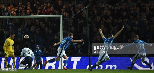 Rochdale's English striker Steven Davies celebrates with teammates after scoring their late second goal during the English FA Cup fifth round...