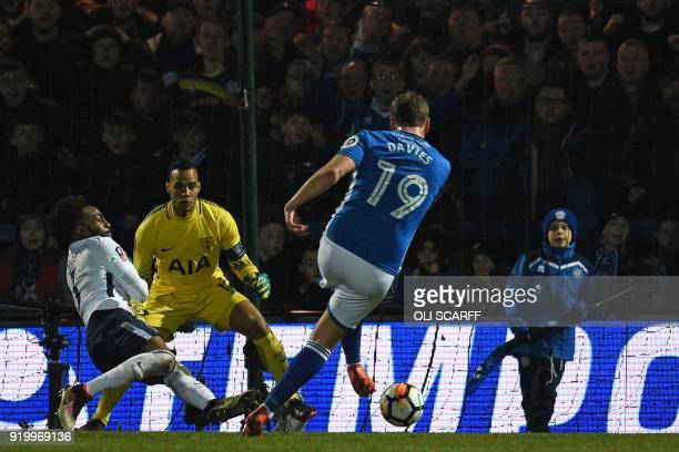 Rochdale's English striker Steven Davies shoots to score their late second goal during the English FA Cup fifth round football match between Rochdale...