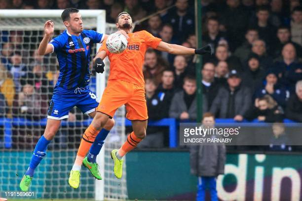 Rochdale's Irish defender Eoghan O'Connell vies with Newcastle United's Brazilian striker Joelinton during the English FA Cup third round football...