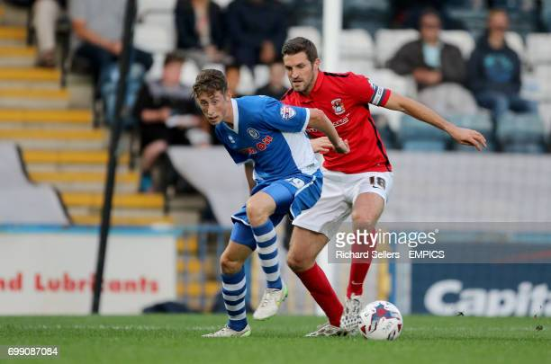 Rochdale's Joe Bunney is shadowed by Coventry City's Sam Ricketts