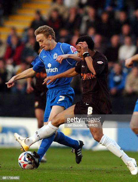 Rochdale's Lee Cartwright is challenged by Barnet's Dean Sinclair