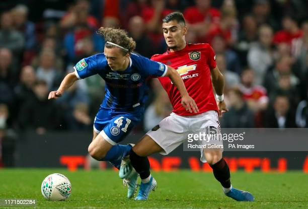 Rochdale's Luke Matheson and Manchester United's Hoelgebaum Andreas Pereira battle for the ball
