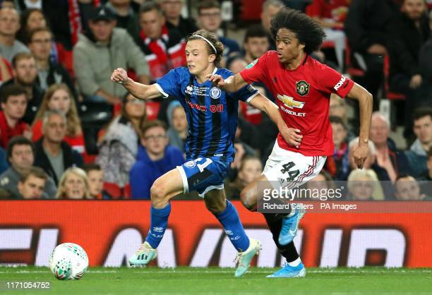 Rochdale's Luke Matheson and Manchester United's Tahith Chong battle for the ball during the Carabao Cup, Third Round match at Old Trafford,...