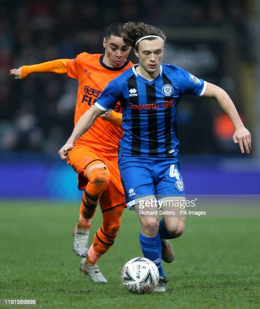 Rochdale's Luke Matheson breaks away from Newcastle United's Miguel Almiron during the FA Cup third round match at The Crown Oil Arena, Rochdale.