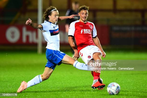 Rochdale's Luke Matheson competes with Fleetwood Town's Eddie Clarke during the EFL Checkatrade Trophy Northern Group B match between Fleetwood Town...