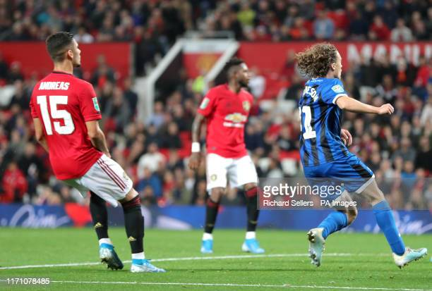 Rochdale's Luke Matheson scores his side's first goal of the game during the Carabao Cup, Third Round match at Old Trafford, Manchester.