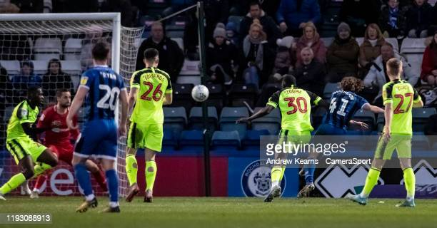 Rochdale's Luke Matheson scoring his side's first goal during the Sky Bet League One match between Rochdale and Bolton Wanderers at Crown Oil Arena...