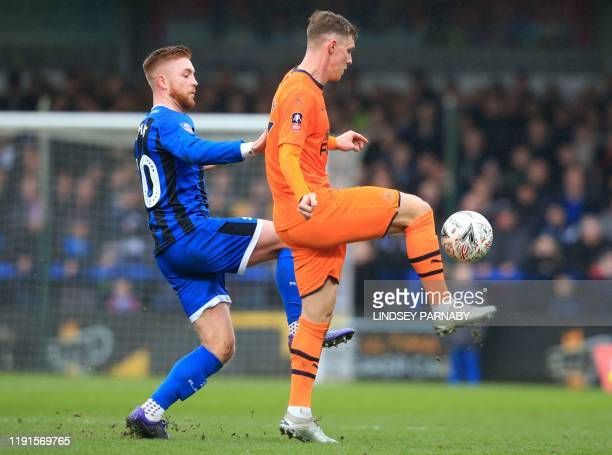 Rochdale's Northern Irish midfielder Callum Camps vies with Newcastle United's Swedish defender Emil Krafth during the English FA Cup third round...