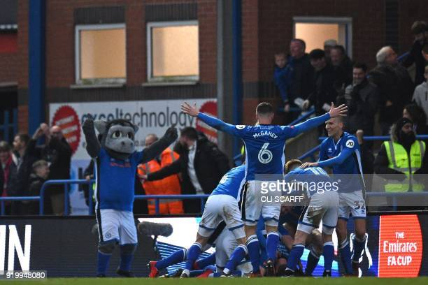 Rochdale's players celebrate after Ian Henderson scores the opening goal of English FA Cup fifth round football match between Rochdale and Tottenham...