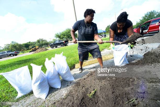 Rochelle and Venicia Crise fill sand bags in preparation for the hurricane Dorian on August 29, 2019 in Casselberry, Florida. The National Hurricane...