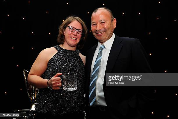 Rochelle Clark of England Women is presented with the Rugby Union Writers' Club Tankard Award by Eddie Jones Head Coach of England during the Rugby...
