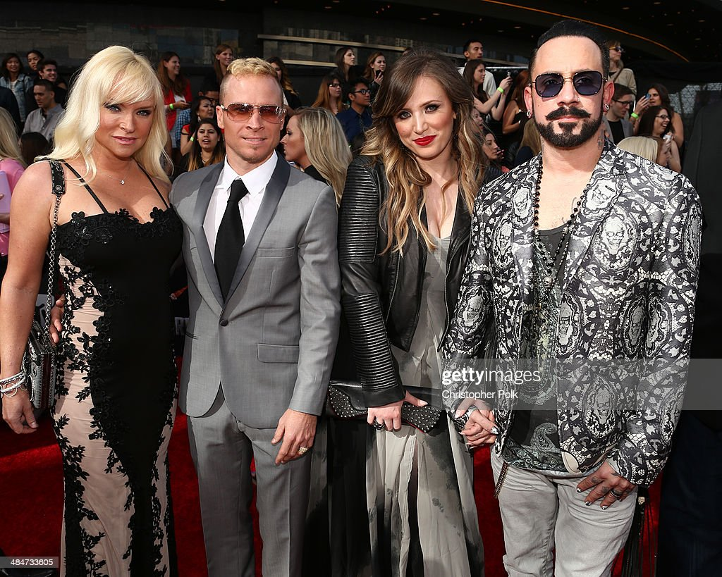 Rochelle Deanna Karidis, singers AJ McLean and Brian Littrell of Backstreet Boys, and Leighanne Littrell attend the 2014 MTV Movie Awards at Nokia Theatre L.A. Live on April 13, 2014 in Los Angeles, California.
