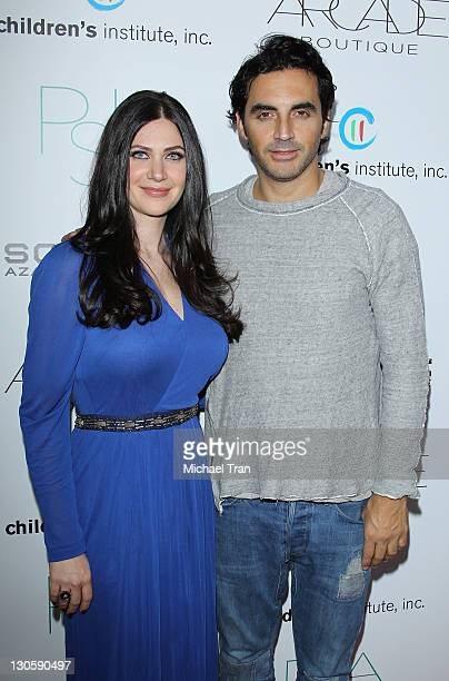 Rochelle Gores Fredston and Yigal Azrouel arrive at the 2nd Annual Autumn Party benefiting Children's Institute held at The London Hotel on October...