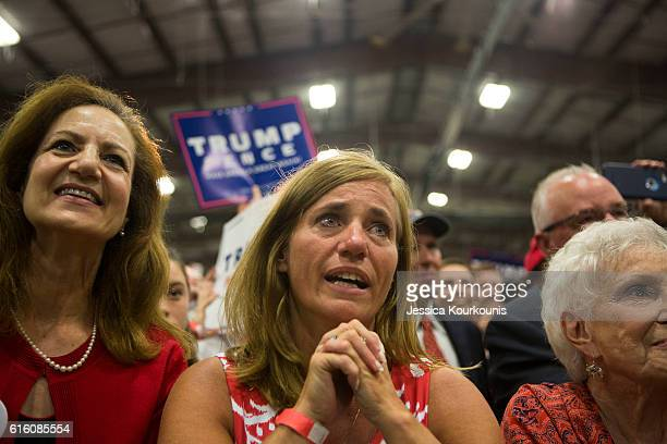 Rochelle Pasquariello center cries while watching Republican presidential nominee Donald Trump at a campaign rally on October 21 2016 in Newtown...