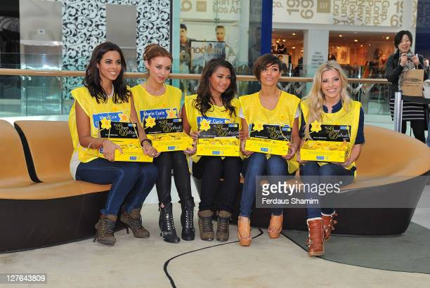 Rochelle Wiseman, Una Healy, Vanessa White, Frankie Sanford and Molly Keane from Saturdays collect money for the Marie Curie Cancer Care's Great...
