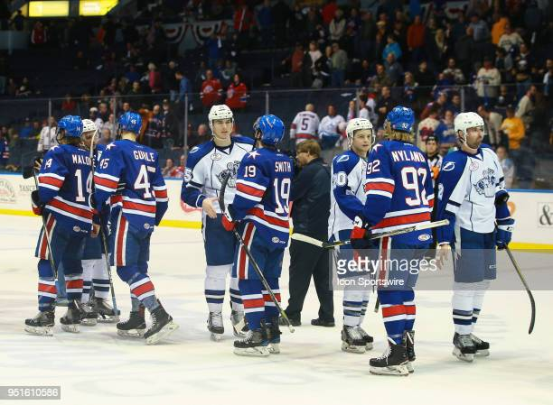Rochester Americans and the Syracuse Crunch meet for the traditional hockey handshake after Syracuse Crunch defeated Rochester Americans in the first...