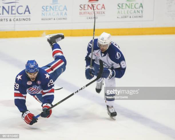 Rochester Americans center Sahir Gill is sent to the ice after an illegal elbow by Syracuse Crunch defenseman Daniel Walcott during an AHL game...