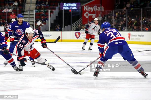 Rochester Americans defenceman John Gilmour steals the puck from Cleveland Monsters right wing Kole Sherwood during the second period of the American...