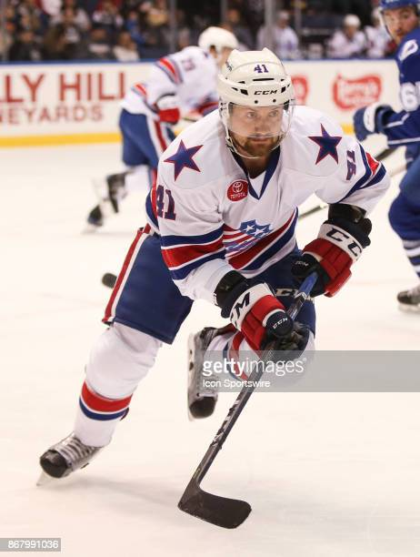 Rochester Americans defenseman Barry Goers clears the puck during an AHL game between the Syracuse Crunch and the Rochester Americans on October 28...