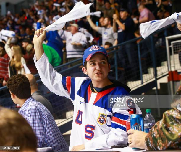 Rochester Americans fan celebrates a second period goal by Rochester Americans right wing Justin Bailey during an AHL game between the Syracuse...