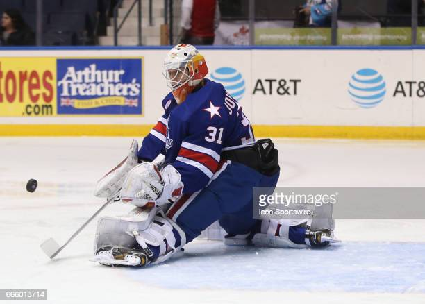 Rochester Americans goalie Jonas Johansson makes a kick save during an AHL game between the Binghamton Senators and the Rochester Americans on April...