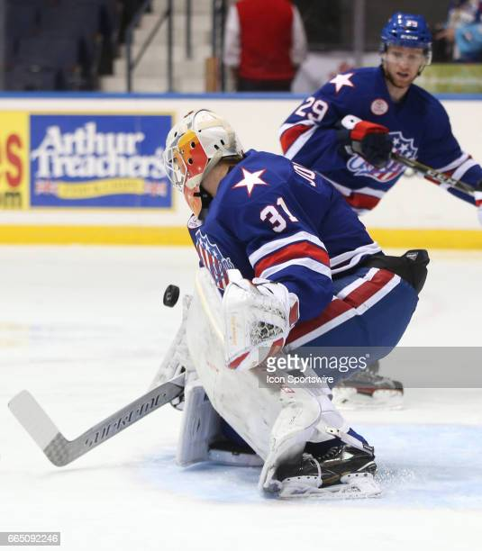 Rochester Americans goalie Jonas Johansson makes a save during an AHL game between the Binghamton Senators and the Rochester Americans on April 05 at...