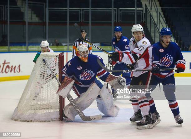 Rochester Americans goalie Jonas Johansson tracks the play while in goal in front of Binghamton Senators left wing Max McCormick during an AHL game...