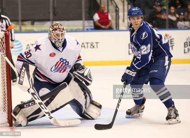 Rochester Americans goalie Linus Ullmark watches for the puck in front of Syracuse Crunch center Matthew Peca during an AHL game between the Syracuse...