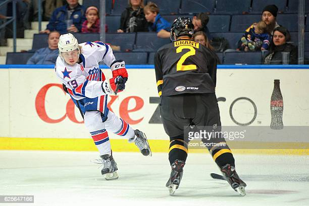 Rochester Americans right wing Alexander Nylander blast a shot past Providence Bruins defenseman Alex Grant during an AHL Hockey game between the...