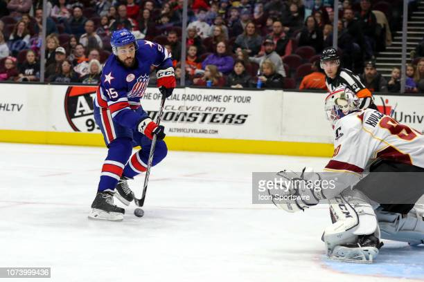 Rochester Americans right wing Justin Bailey shoots against Cleveland Monsters goalie Matiss Kivlenieks during the first period the American Hockey...
